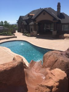 Custom Utah Backyard Swimming Pool & Rock Design