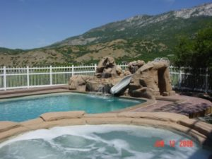 Custom Hot Tub & Outdoor Swimming pool with slide