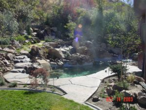 Small backyard pool and landscaping