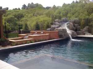 Waterfall and Slide by Pool