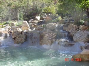 Layered Backyard Waterfall & Custom Rock Design Utah