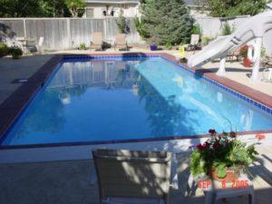 custom backyard pool and water slide Utah
