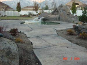 Backyard Concrete Deck Pool Waterfall